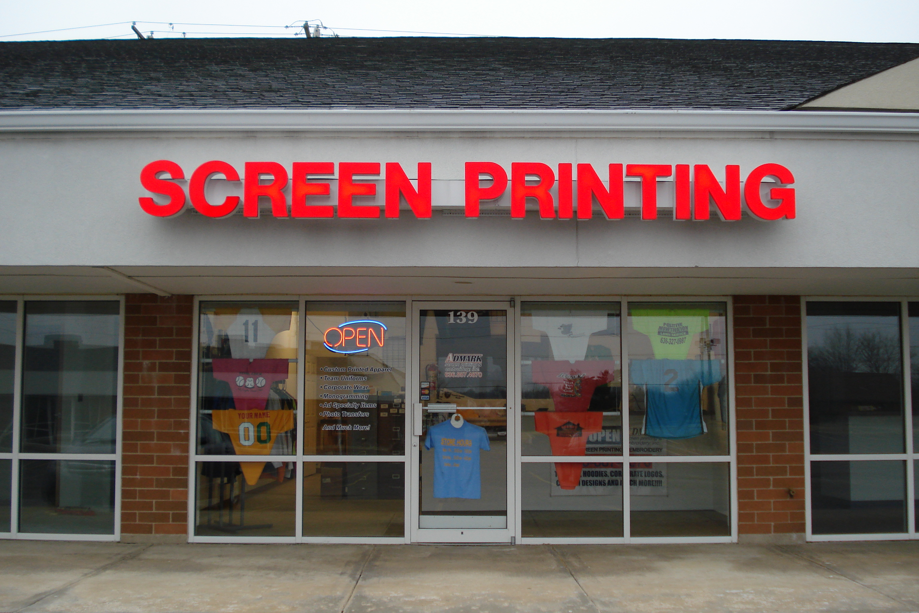 Admark screen printing embroidery inc home for T shirt printing st charles mo